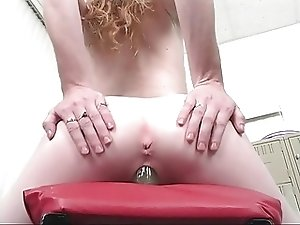 Redhead with small tits and nice ass dildo fucks cunt
